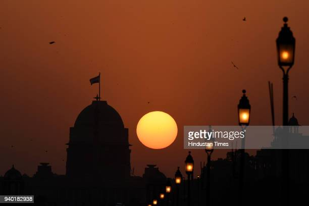 Sun sets in the backdrop of Rashtrapati Bhawan on March 30 2018 in New Delhi India