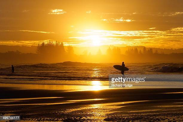 Sun sets on a lone surfer