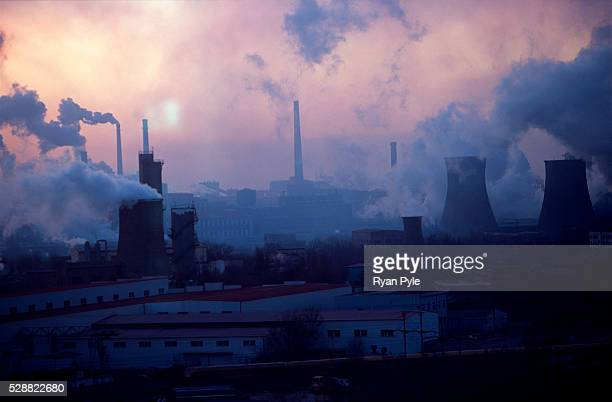 Sun sets on the Bao steel mill in Baotou, Inner Mongolia, China. Baotou is an excellent example of a one-industry town, and that industry is steel....