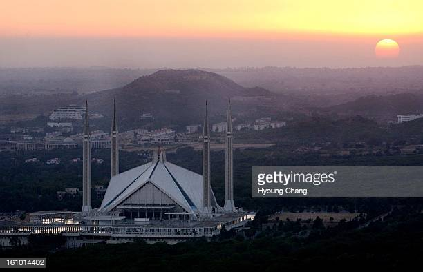 Sun sets over the Shah Faisal Mosque Islamabad Pakistan The mosque is said to be Asia's biggest with room for 100000 worshippers Art for trent's...