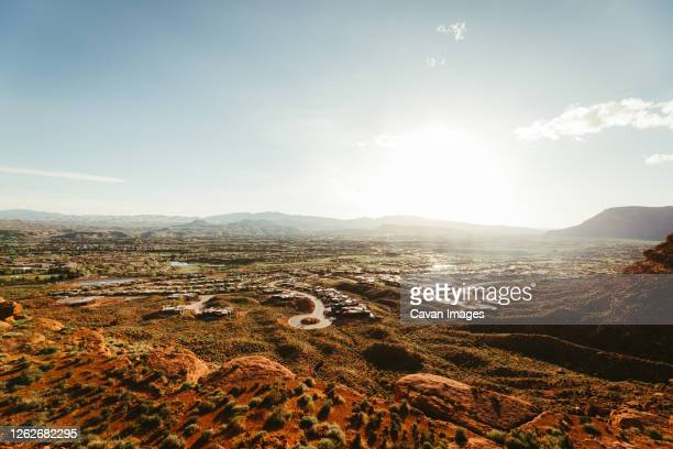sun sets over wealthy retirement community in desert of st. george - st. george utah stock pictures, royalty-free photos & images