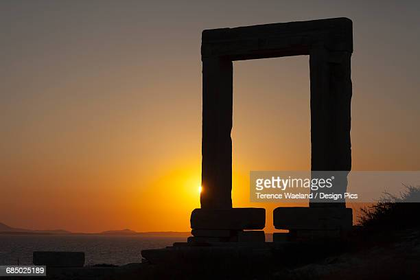 sun setting at apollo temple - terence waeland stock pictures, royalty-free photos & images