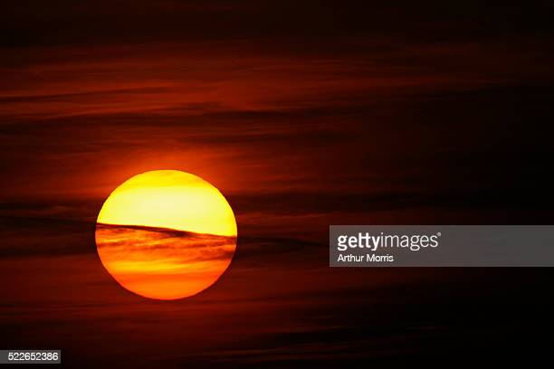 Sun Setting Behind Dark Clouds