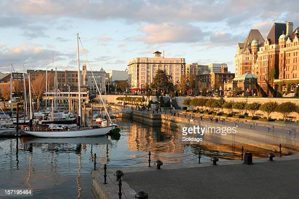 sun setting on victoria harbour and empress hotel in springtime. - victoria canada stock pictures, royalty-free photos & images
