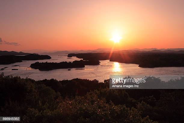 sun setting over ago bay - 伊勢志摩 ストックフォトと画像