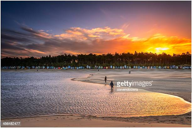 Sun setting over beach huts at Wells