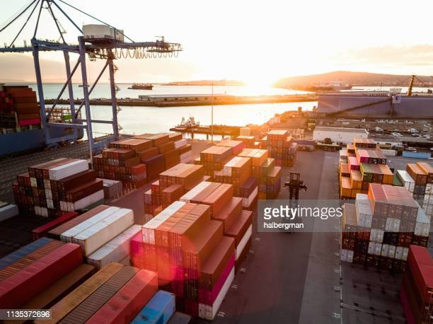 sun setting over container terminal in the port of long beach - port of los angeles stock pictures, royalty-free photos & images