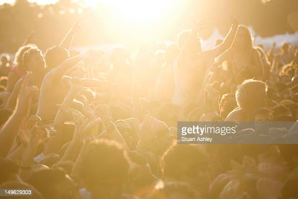 Sun setting over crowd at music festival
