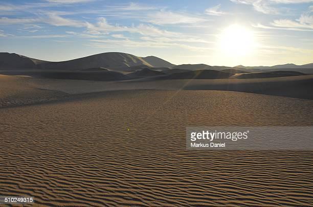 Sun setting over desert near Huacachina