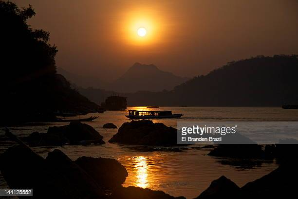 Sun Setting Over Mekong In Laos