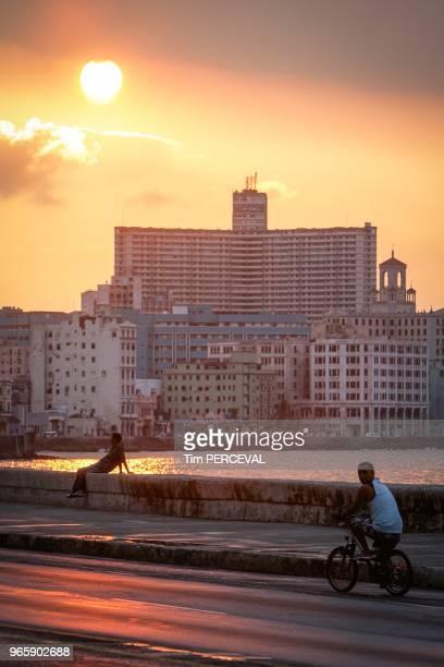 Sun setting over the Edificio Focsa from the Malecon Havana
