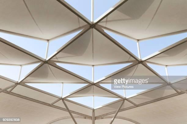 Sun shading system from below. Siemens Masdar, Abu Dhabi, United Arab Emirates. Architect: Sheppard Robson, 2014.