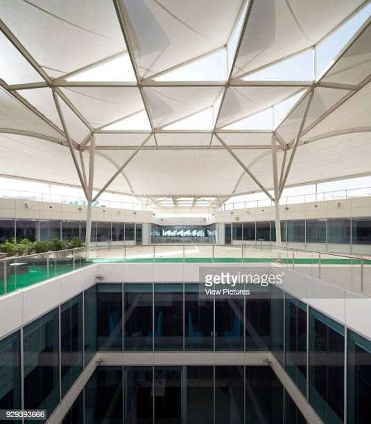 Sun shading with roof terrace and lightwell. Siemens Masdar, Abu Dhabi, United Arab Emirates. Architect: Sheppard Robson, 2014.