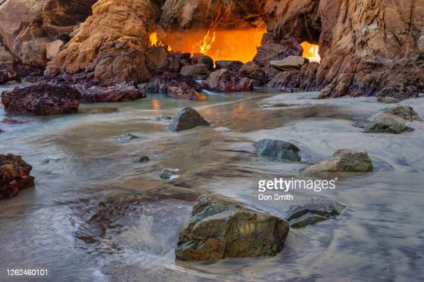 sun shaft through big sur sea arch - don smith stock pictures, royalty-free photos & images