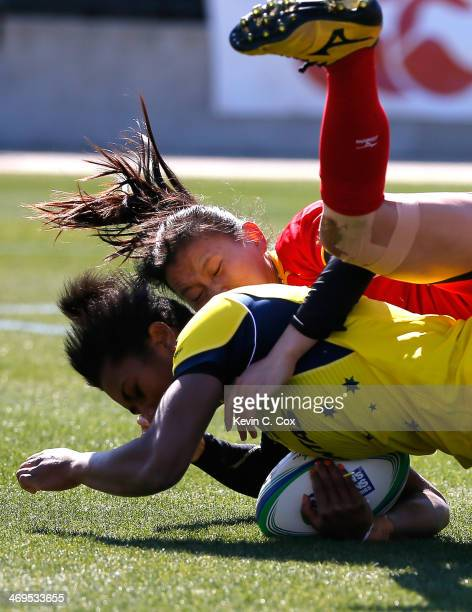 Sun Shichao of China tackles Ellia Green of Australia during the IRB Women's Sevens World Series at Fifth Third Bank Stadium on February 15, 2014 in...
