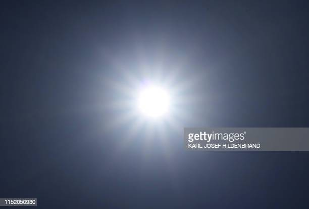 Sun shines from a cloudless sky in Kempten, southern Germany, where temperatures reached around 34 degrees Celsius on June 26, 2019. - Meteorologists...