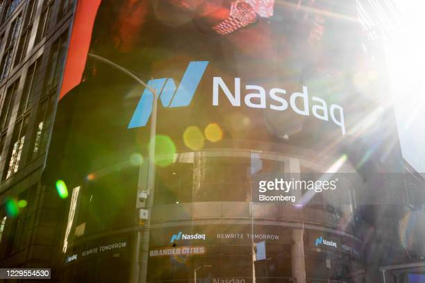 Sun shines outside of the Nasdaq MarketSite in New York, U.S., on Monday, Nov. 9, 2020. Stockssurged around the world and bonds tumbled after a...