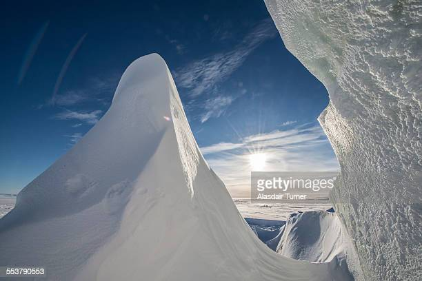 Sun shines through a crack in an iceberg in McMurdo Sound on the Ross Sea, Antarctica.