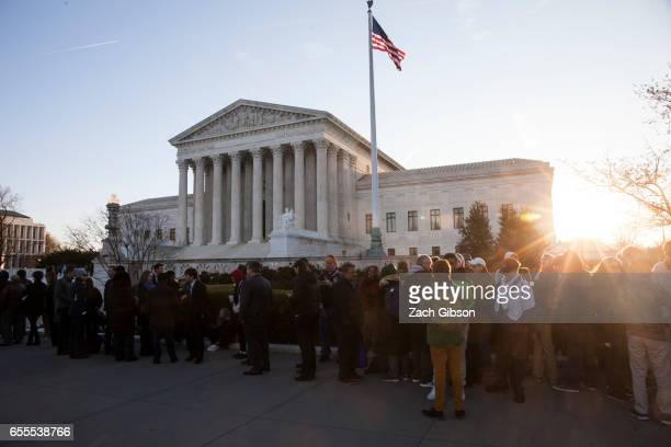 Sun shines through the people waiting outside The United States Supreme Court building on March 20 2017 in Washington DC The Senate will hold a...