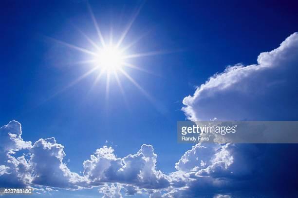 Sun Shining Amidst Cumulus Clouds