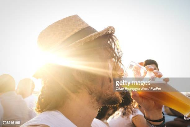 Sun Shining From Behind Hipster Man