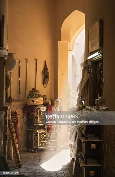Sun shining in door of indoor market