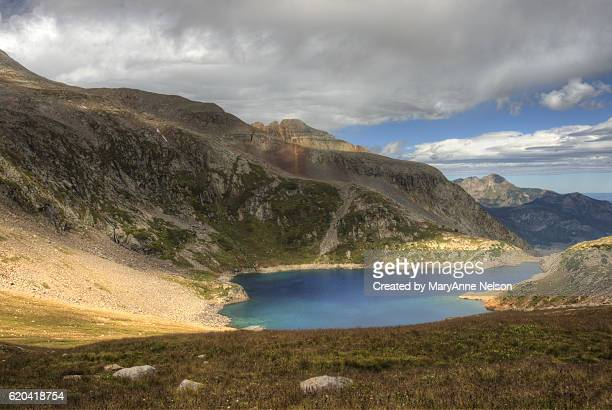 sun shining on mountain lake - mary lake stock photos and pictures