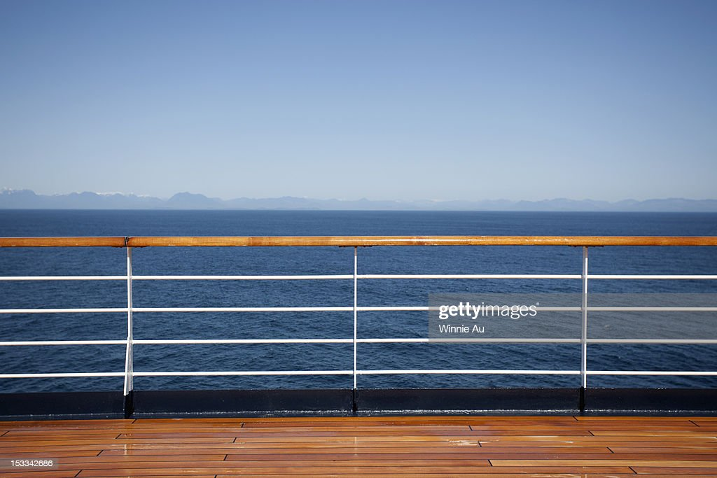 Sun shining on the boat deck of a passenger ship, Canadian coastline in background : Stock Photo