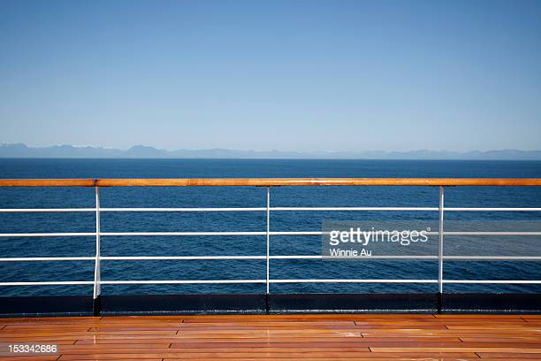 sun shining on the boat deck of a passenger ship, canadian coastline in background - ponte di una nave foto e immagini stock