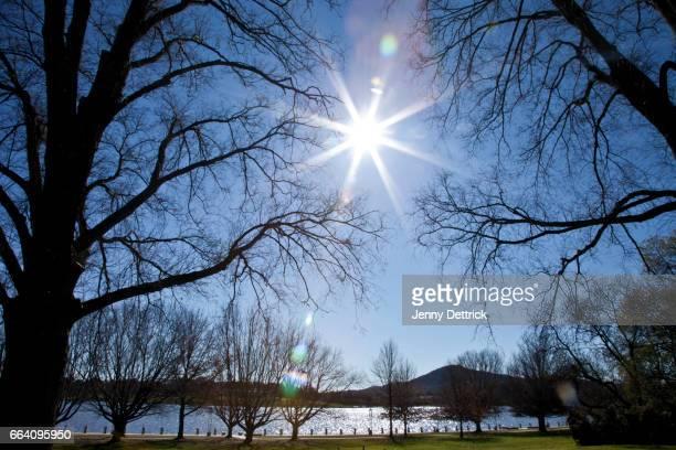 Sun shining over lake in winter