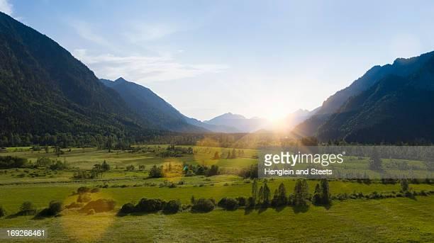 Sun shining over rural landscape