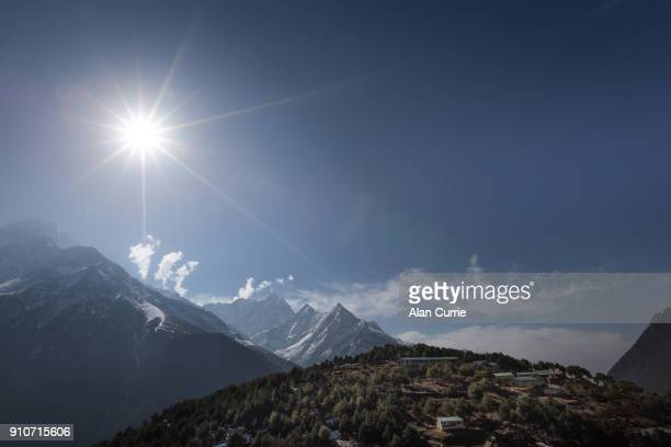 sun shining over village on trail to Mount Everest Base Camp