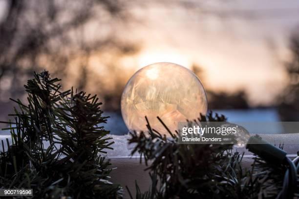 Sun shining through a frozen bubble