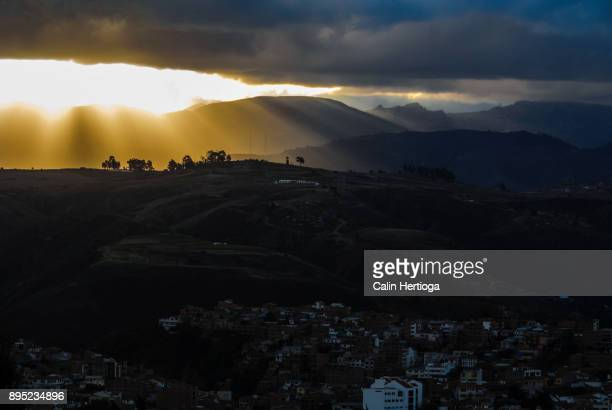 sun shining through clouds on top of a hill in sucre, bolivia - protruding stock pictures, royalty-free photos & images