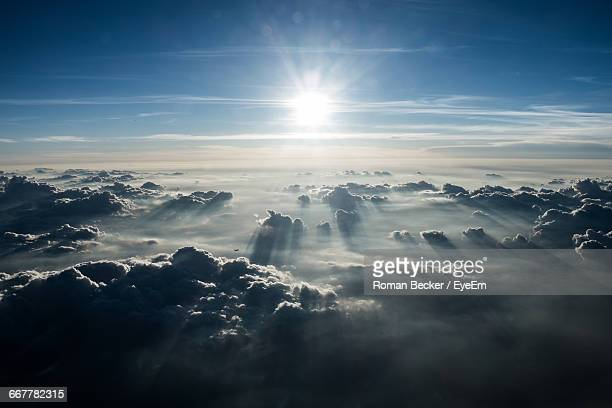 sun shining through clouds - elysium stock pictures, royalty-free photos & images