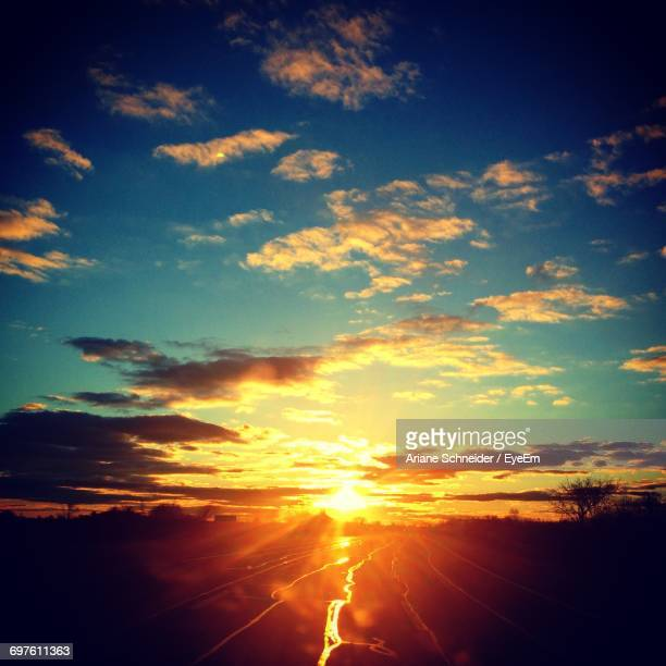 sun shining through clouds - wantagh stock pictures, royalty-free photos & images