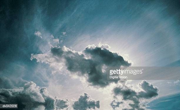 Sun shining through cumulus clouds