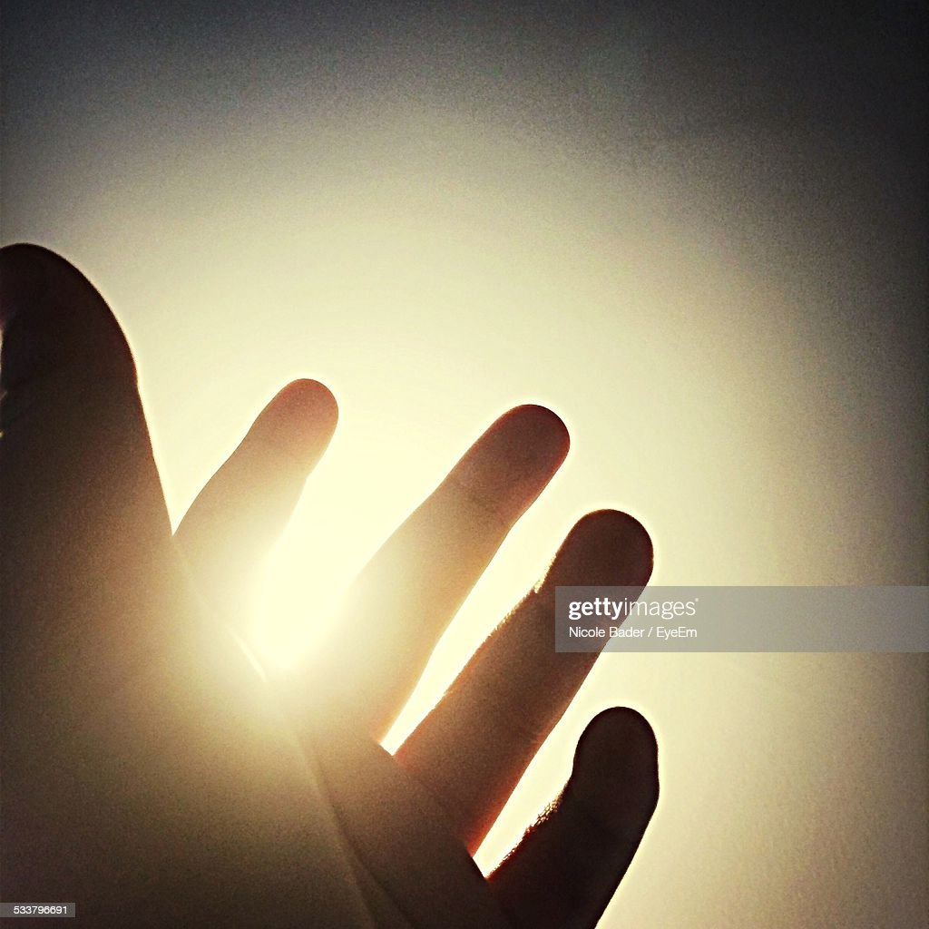 Sun Shining Through Human Hand : Foto stock