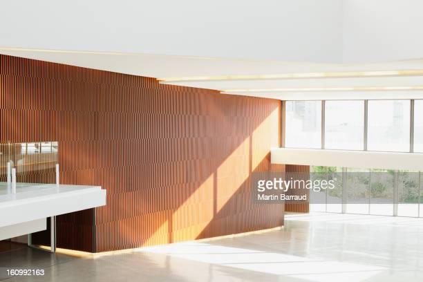 Sun shining through windows in empty modern lobby