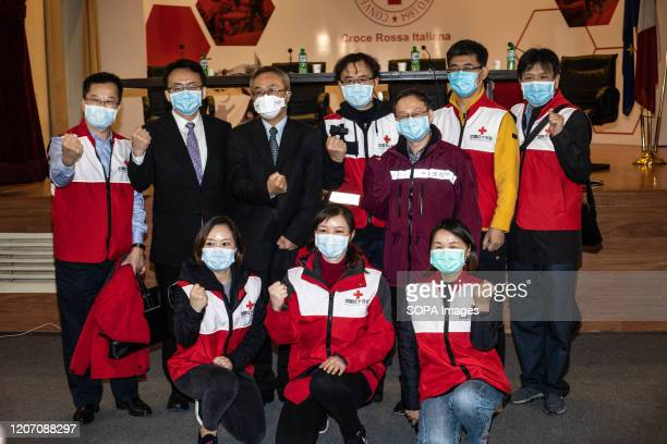 Sun Shuopeng, the vice president of the Chinese Red Cross and the Chinese ambassador to Italy Li Junhua pose for a photo after the press conference...