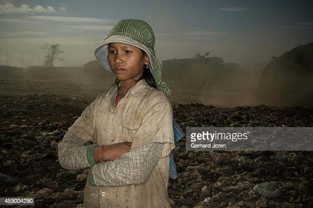 Sun Sok Jeng 13 years old works full time at the dump and earns USD 1 a day She has been here for over one year She has found all her clothes at the...