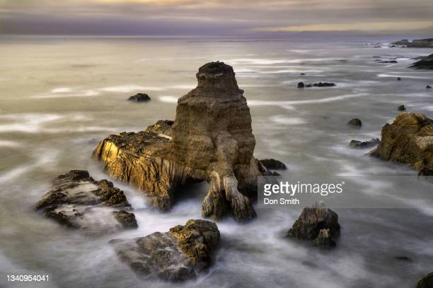 sun splash on grotto rock, montana de oro state park, los osos, california - smith rock state park stock pictures, royalty-free photos & images