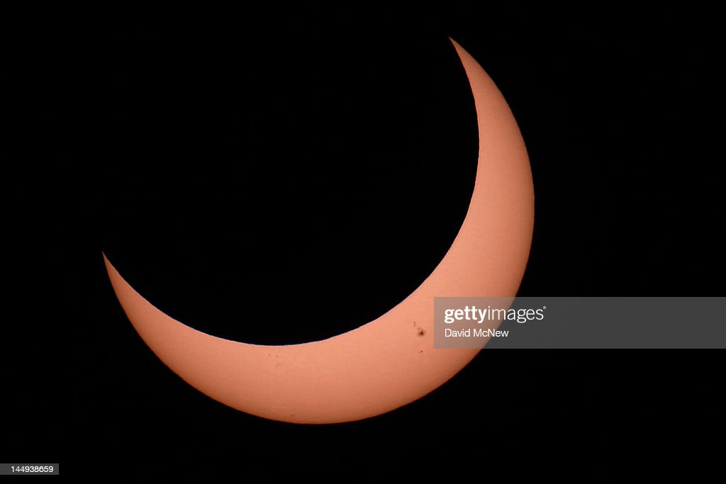Sun spots are seen as the moon moves into a partial eclipse position after reaching annularity during the first annular eclipse seen in the U.S. since 1994 on May 20, 2012 in Grand Canyon National Park, Arizona. Differing from a total solar eclipse, the moon in an annular eclipse appears too small to cover the sun completely, leaving a ring of fire effect around the moon. The eclipse is casting a shallow path crossing the West from west Texas to Oregon then arcing across the northern Pacific Ocean to Tokyo, Japan.