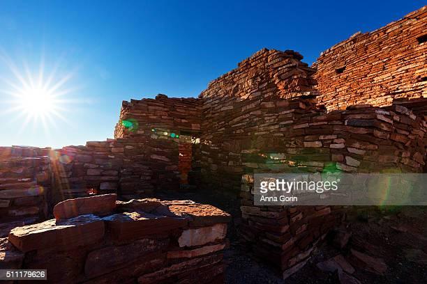 Sun star and lens flare above Lomaki pueblo ruins at Wuptaki National Monument, Arizona