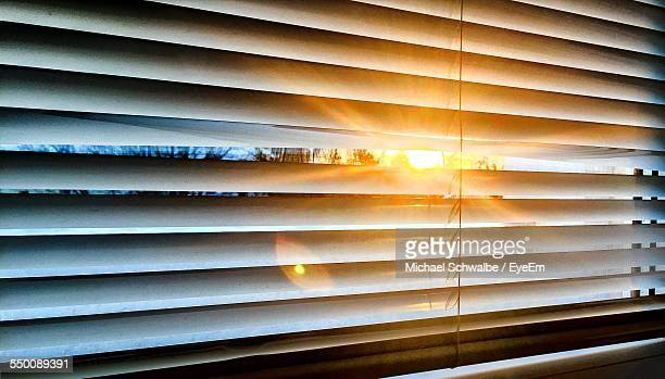 sun streaming through blinds - blinds stock pictures, royalty-free photos & images
