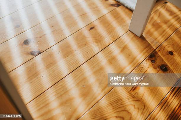 sun streams across floor - lighting equipment stock pictures, royalty-free photos & images