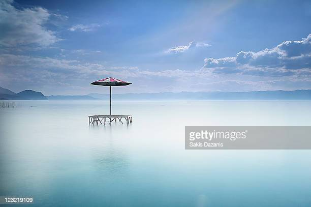 sun umbrella  in lake ohrid - lake ohrid stock photos and pictures