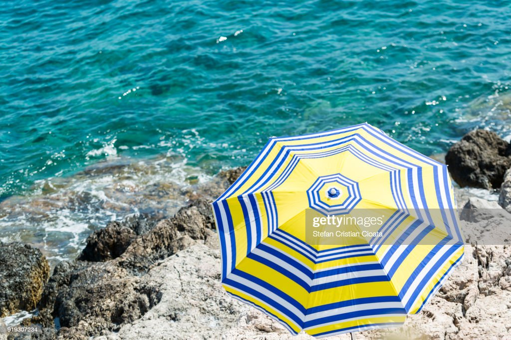 Sun umbrella on Greece shore : Stock Photo
