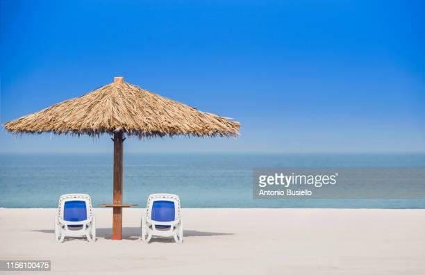 sun umbrella - ras al khaimah stock pictures, royalty-free photos & images