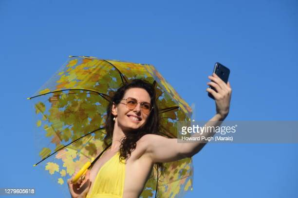 sun umbrella weather - weather stock pictures, royalty-free photos & images